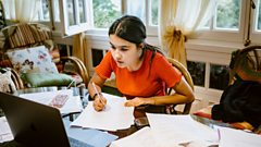 A girl studies at home