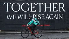 A cyclist passes a mural in Dublin City centre as the Irish government considers new coronavirus restrictions
