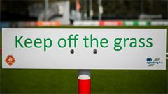 A keep off the grass sign
