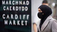 Woman in mask outside Cardiff market