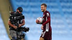Jamie Vardy being filmed by a TV cameraman