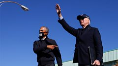 Democratic U.S. presidential nominee and former Vice President Joe Biden and former U.S. President Barack Obama gesture at a campaign drive-in, mobilization event in Flint, Michigan, U.S., October 31, 2020