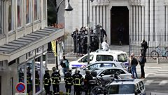 French police officers stand at the entrance of the Notre Dame Basilica church in Nice, France, 29 October 2020