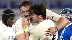 Jonny Hill and Tom Curry hug in celebration