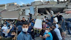 Rescuers and local residents search for survivors after a building collapsed in Izmir, Turkey. Photo: 30 October 2020