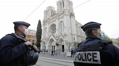 Armed French police guard outside the Notre-Dame basilica in Nice, France. Photo: 29 October 2020