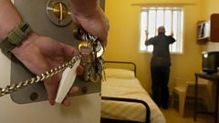 Man in a prison cell