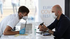"A man shows his phone for a worker as he registers to receive a coronavirus disease (COVID-19) test at a COVID-19 testing centre at Brussels"" Zaventem airport premises to allow travellers coming from a highly-infected zone to get rapidly tested, in Zaventem, Belgium September 14, 2020."