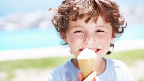 Young boy eating an ice cream