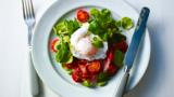 Fried bacon with poached egg and tomatoes