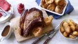 Roast rib of beef and bone marrow gravy with roast potatoes