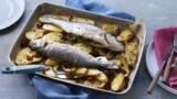 Whole baked fish with potatoes, lemon and sundried tomatoes