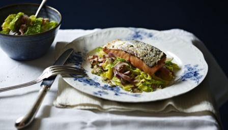 Grilled salmon, braised cabbage with bacon and onions