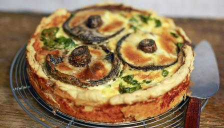 Spinach, mushroom and ricotta quiche with sautéed spinach