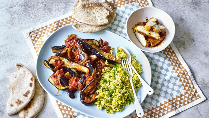 Aubergines in tamarind sauce with baked halloumi and saffron rice
