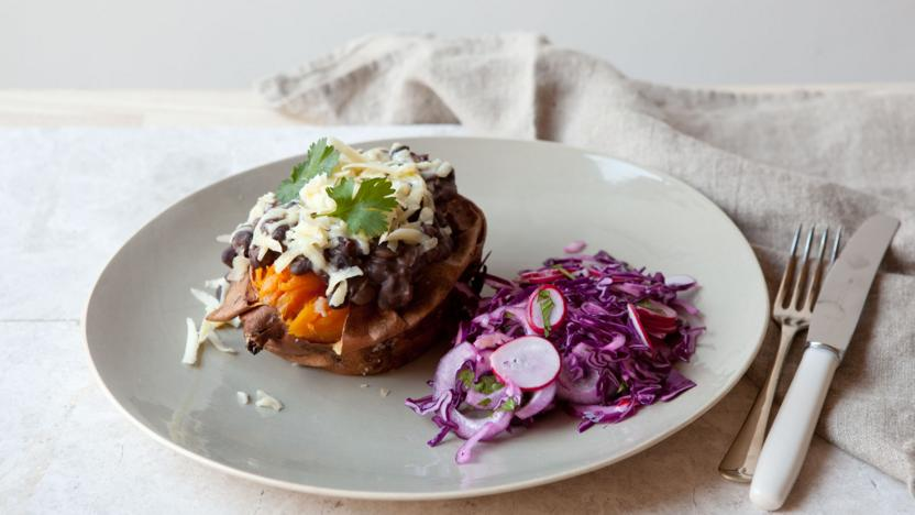 Baked sweet potato with easy black beans and purple slaw