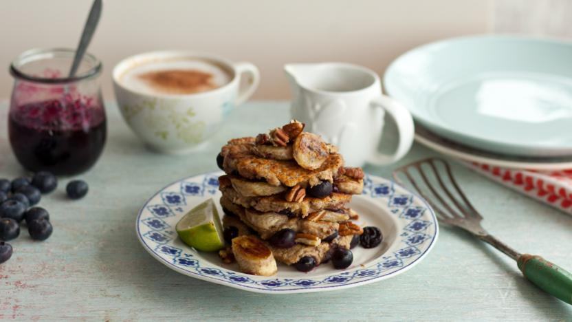 Vegan banana pancakes with blueberries and pecans
