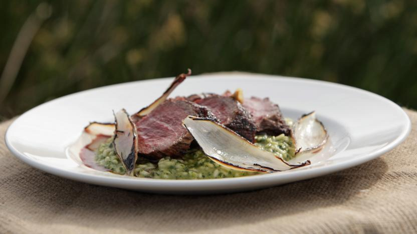 Beef with a garlic and parsley risotto and roasted shallots