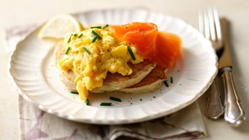 Buckwheat blinis with scrambled eggs and smoked salmon