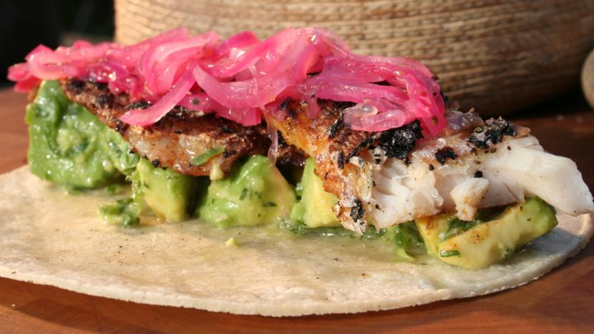 Crisp sea bass tortillas with pink pickled onion