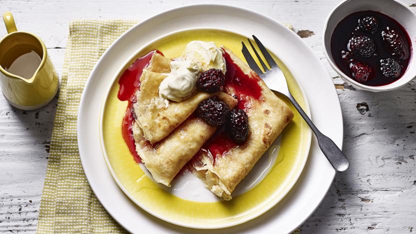 Pancakes with vodka lemon drizzle and blackberry compôte