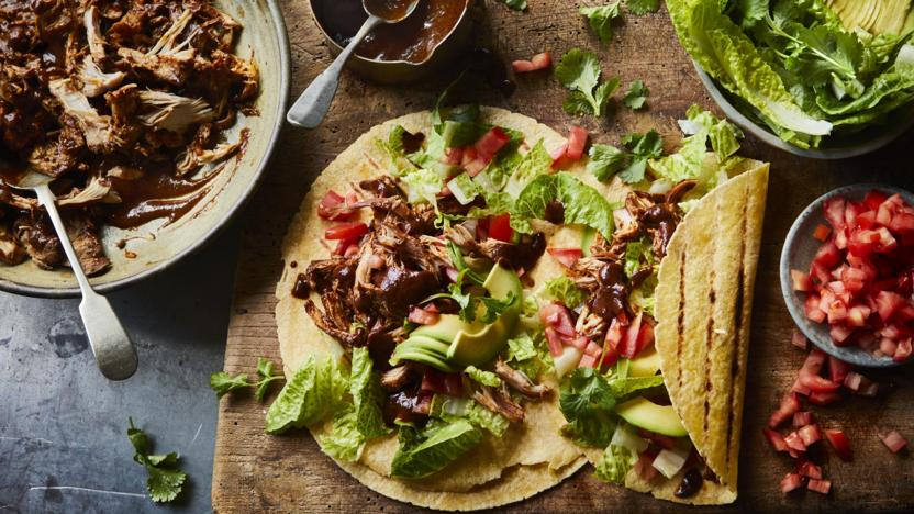 Pulled chicken tacos with chocolate mole sauce