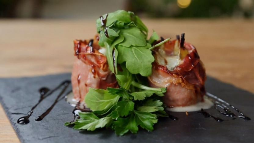 Roasted figs wrapped in Parma ham with blue cheese and rocket