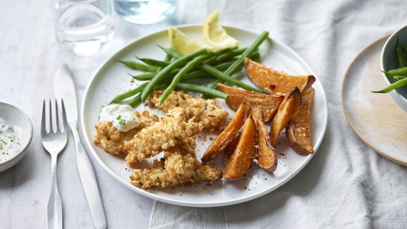 Spiced puffed rice chicken goujons with sweet potato wedges