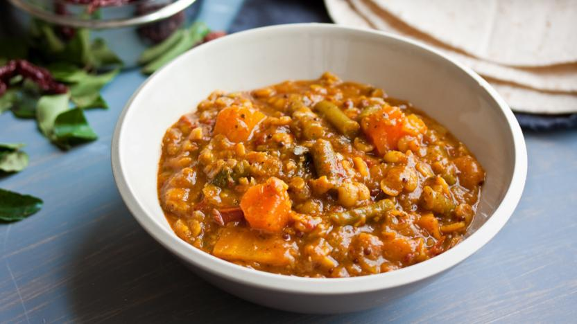 Spicy lentil soup with squash, tomato and green beans (sambar)