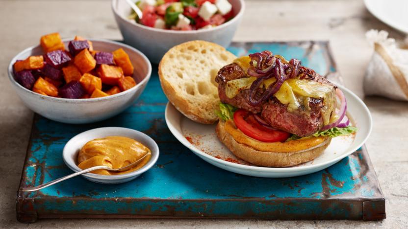 Suya fillet burger with sweet potato cubes and watermelon salad