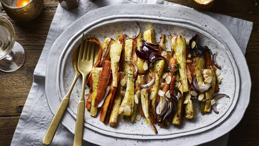 Thyme-roasted carrots and parsnips with orange, cardamom and almonds