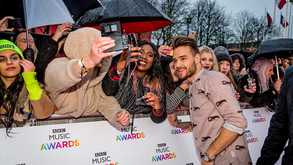 The boys posing with Directioners before the BBC Music Awards 2015