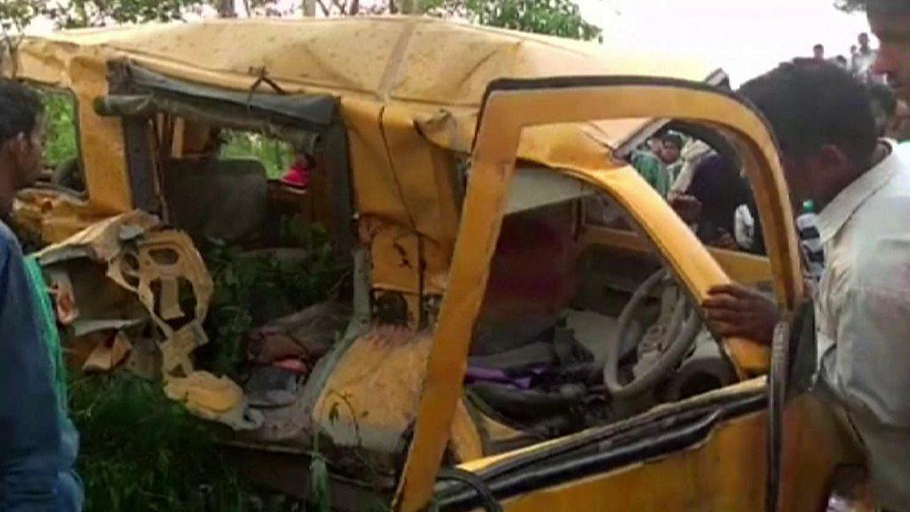Children die as school bus hits train