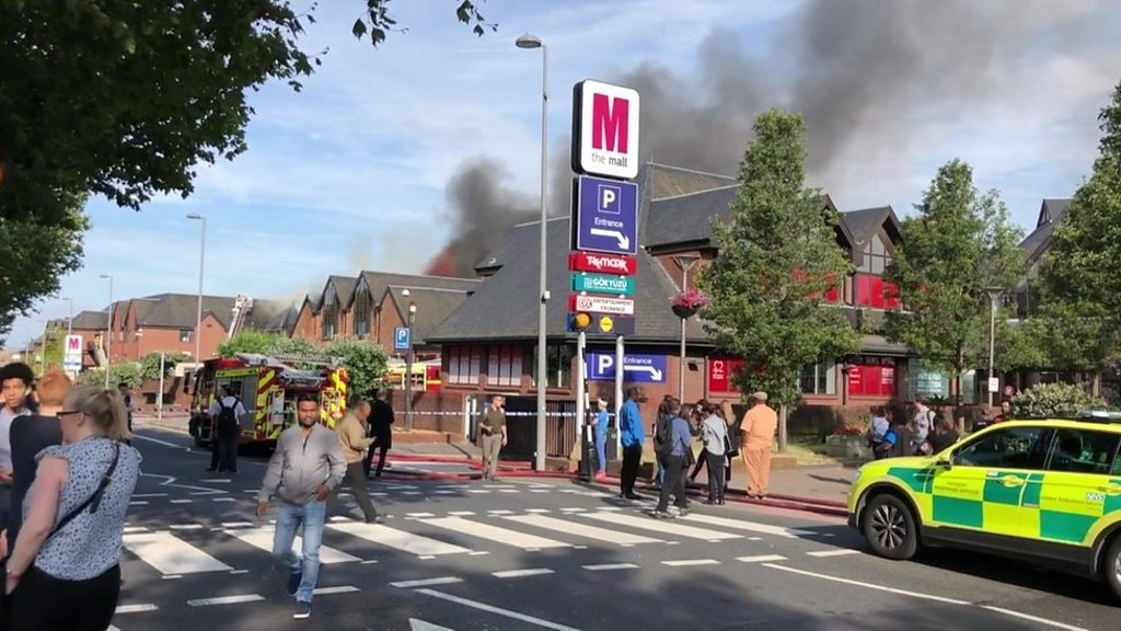 Firefighters Tackle Blaze At Shopping Centre