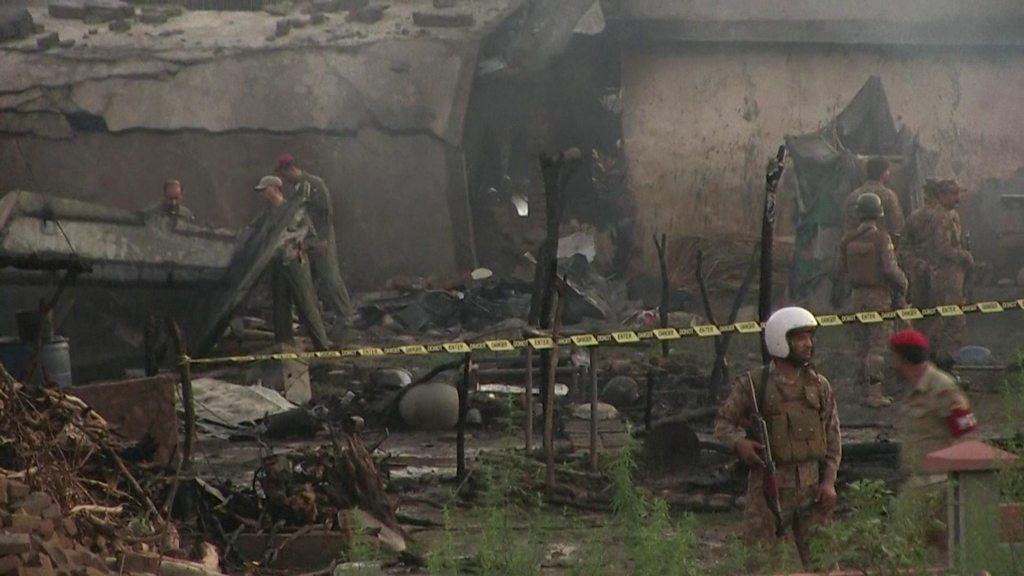 Pakistan army plane crashes into houses, killing 18