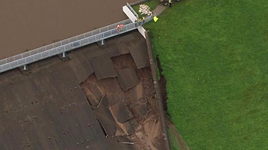 Town evacuated as dam wall collapses