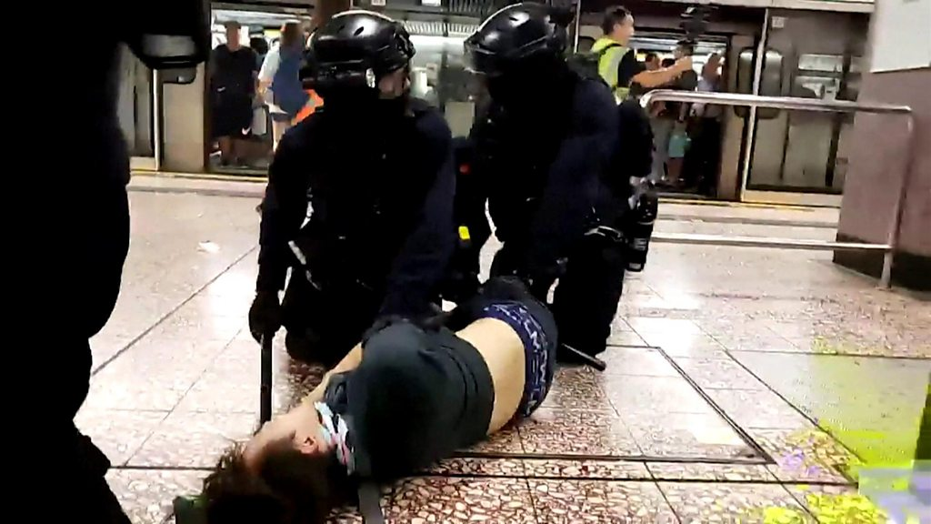 Hong Kong police storm metro system after protests