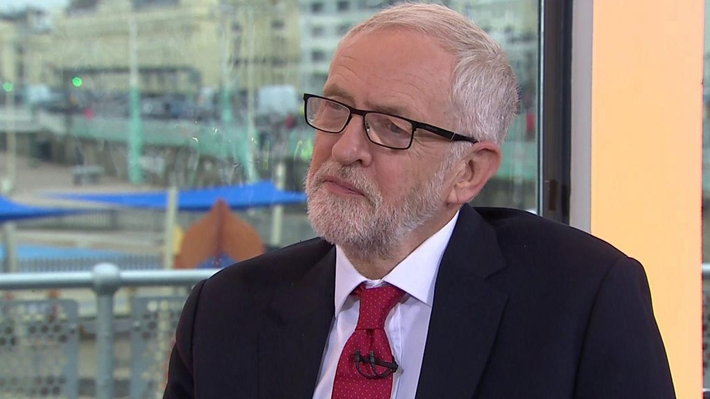 Labour party conference: Corbyn plays down divisions amid aide's exit