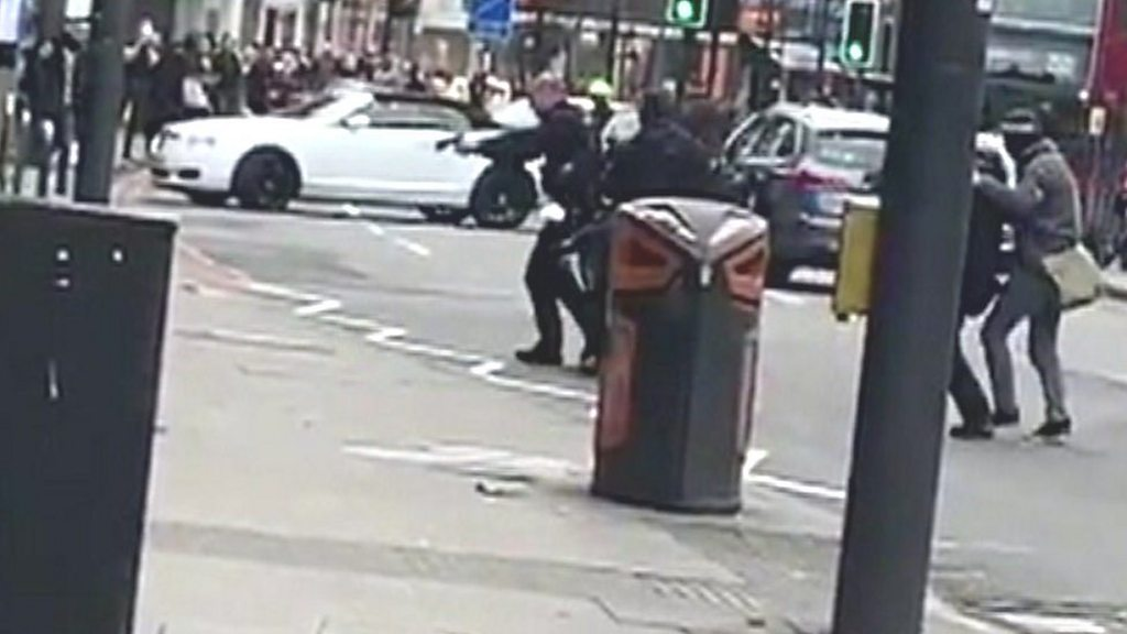 Man shot dead by police after stabbings in London
