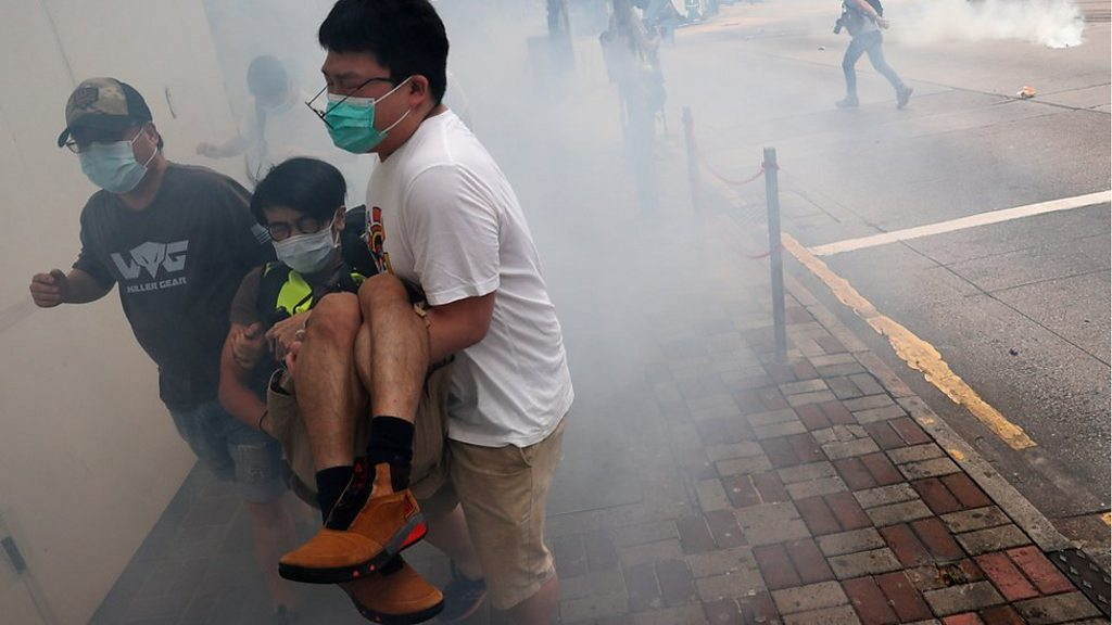 Hong Kong police fire tear gas as protesters decry China security law plan - BBC News