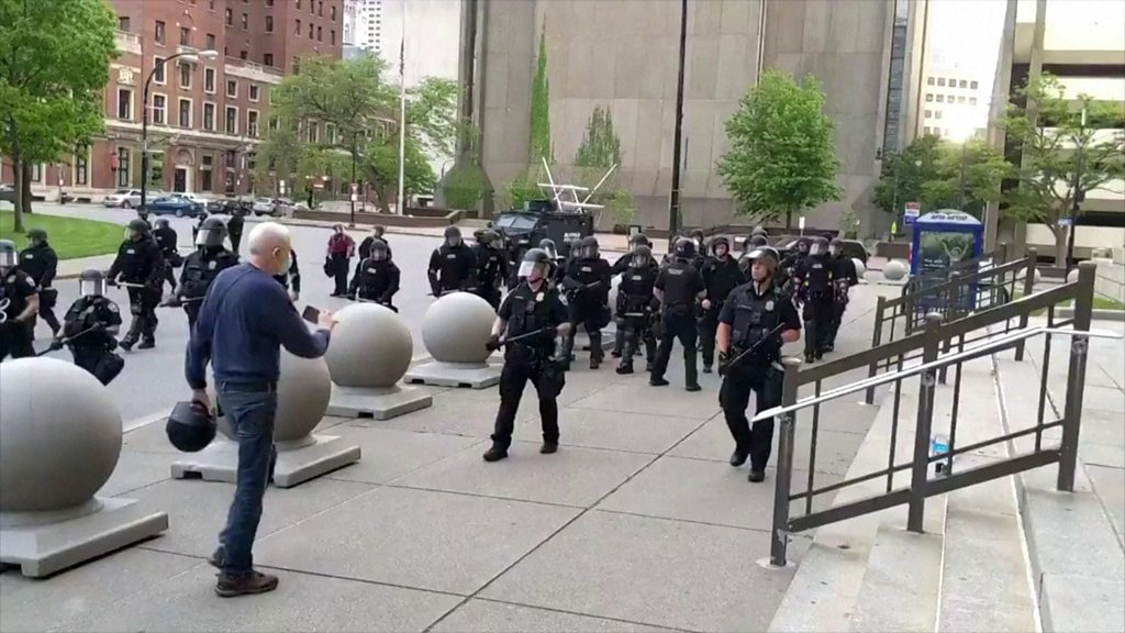 Buffalo police riot squad quit to back officers who shoved man - bbc