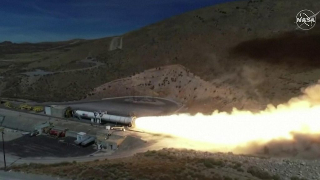 Moon booster rocket fired up in critical test thumbnail