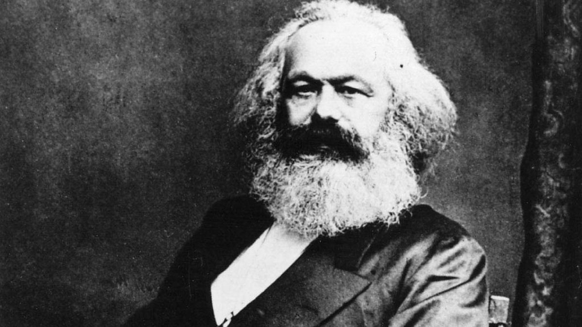 a biography of karl marx who theorized the materialist conception of history
