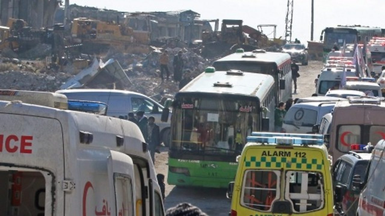 Syria civil war: First buses leave rebel-held eastern Aleppo