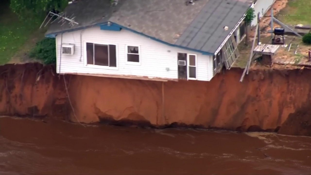 Homes hanging over river bank in Oklahoma