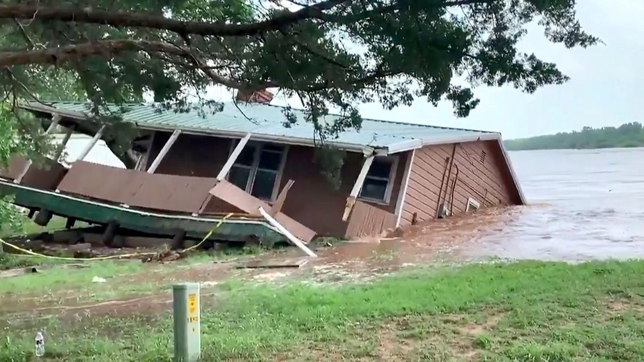 Home swept into river in US