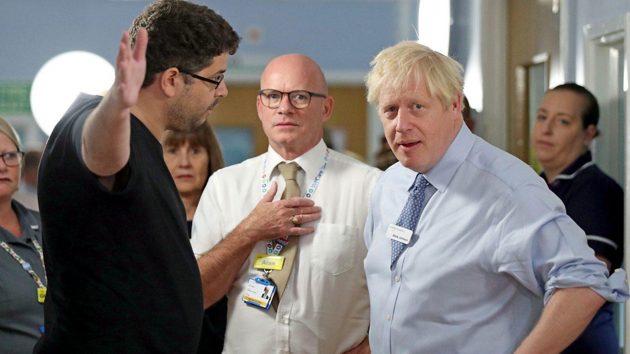 Boris Johnson confronted on east London hospital visit
