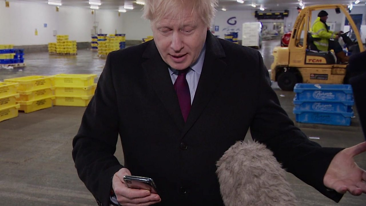 General election 2019: Johnson puts reporter's phone in pocket