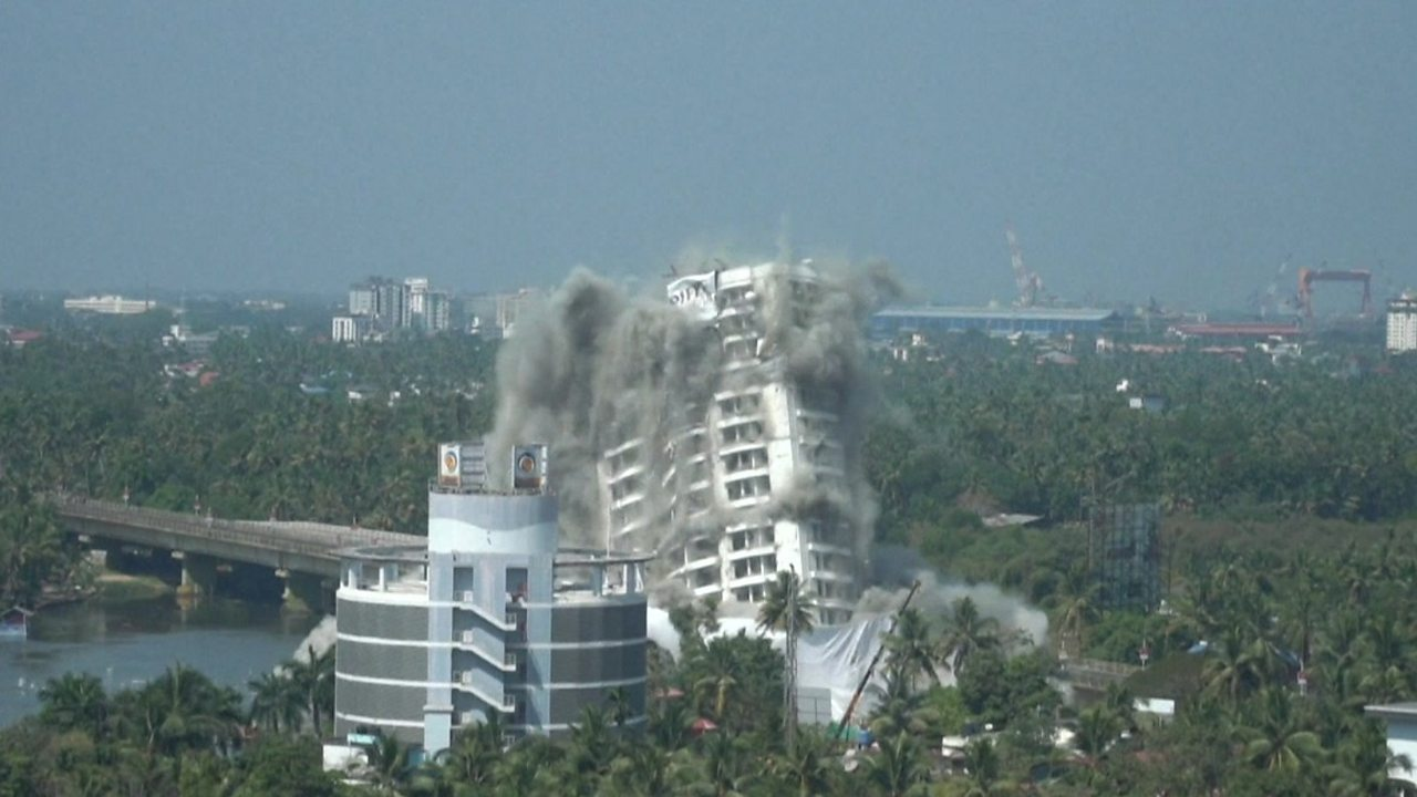 Watch the moment a luxury high-rise building is demolished
