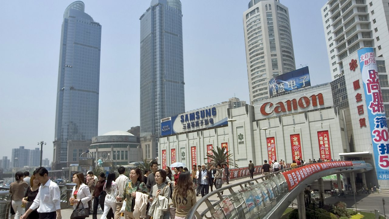 A busy Shanghai street with large businesses, skyscrapers and offices.